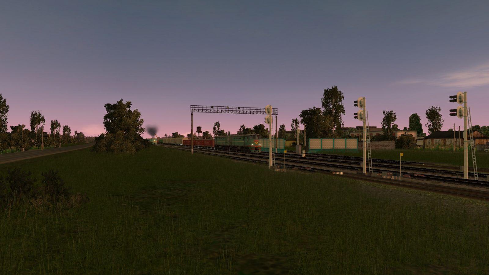 Локомотив ТЭ3 с грузовым поездом.