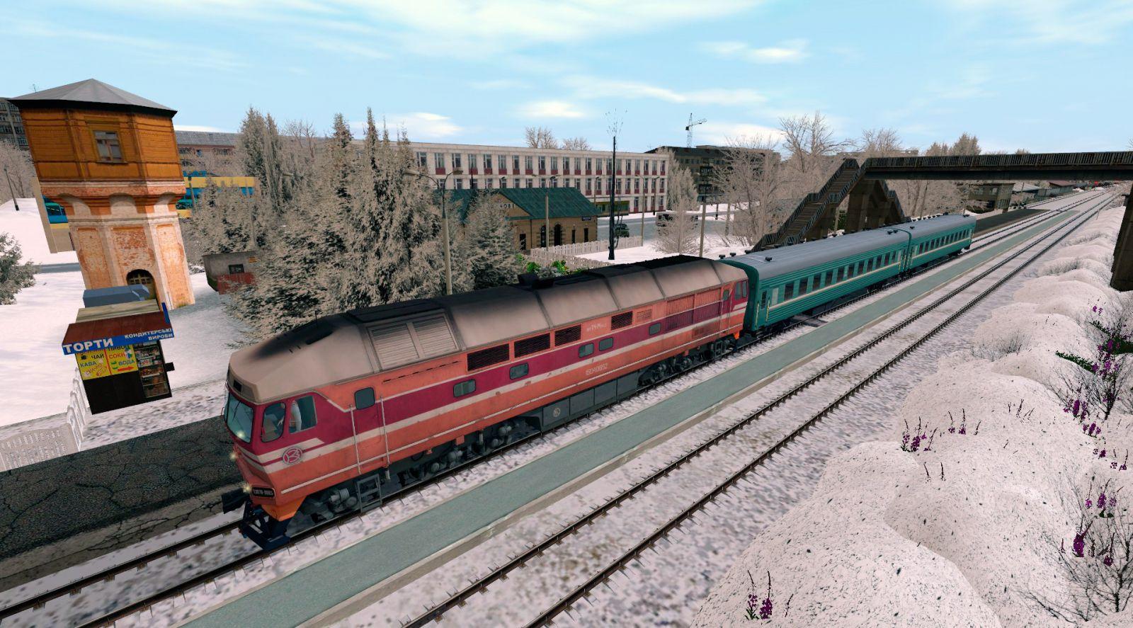 Тепловоз ТЭП70-0065 с пригородным поездом на станции Лихачово